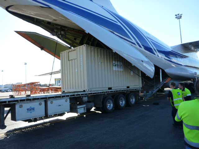 Truck loading freight from plane